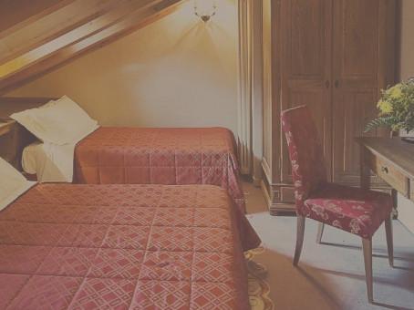 Camera letto Hotel Cly
